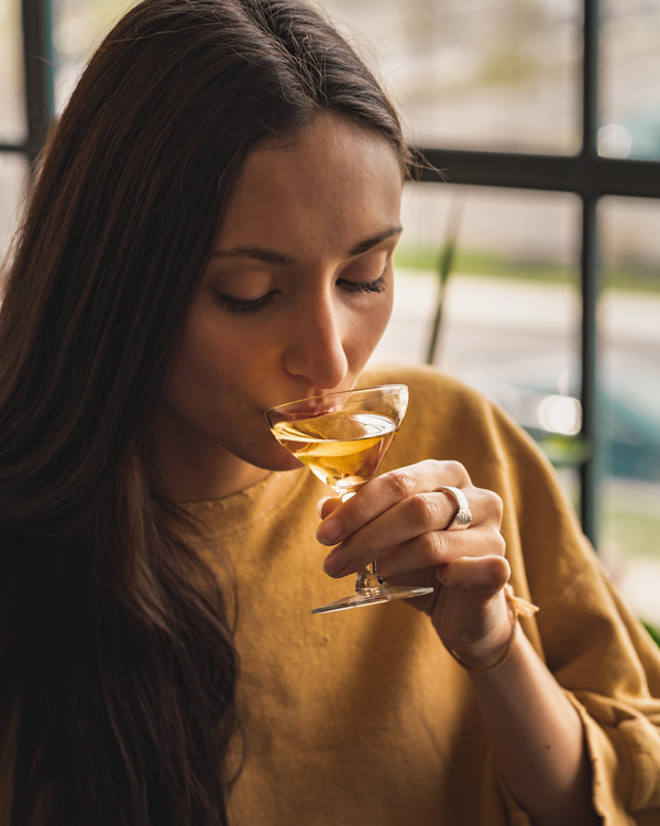 Woman sipping Lillet Blanc