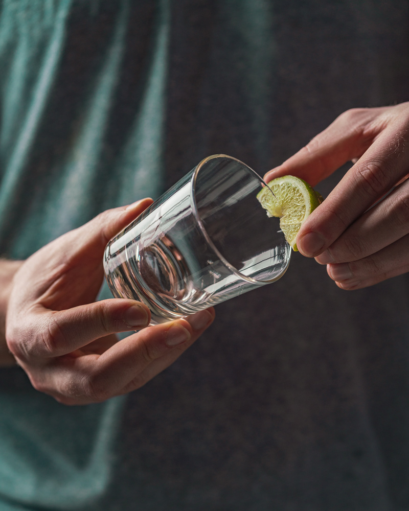 putting lime on the rim of the margarita glass