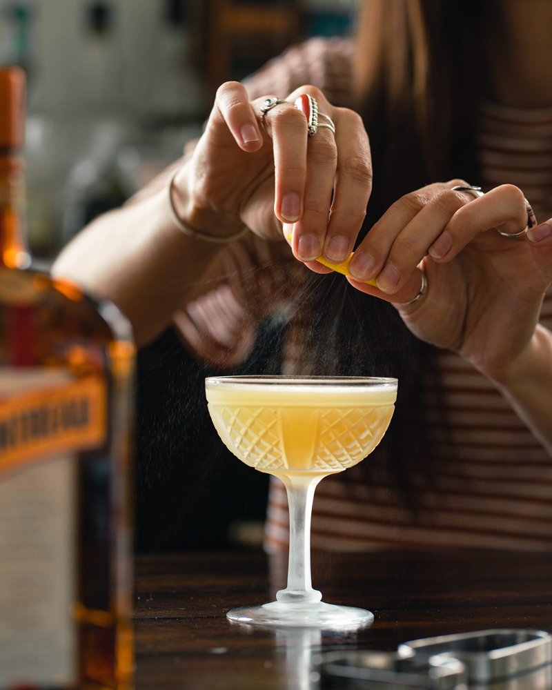 Expressing Citrus on the Sidecar cocktail
