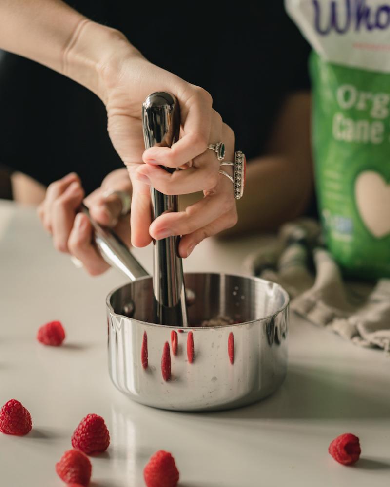 Muddling fresh raspberries