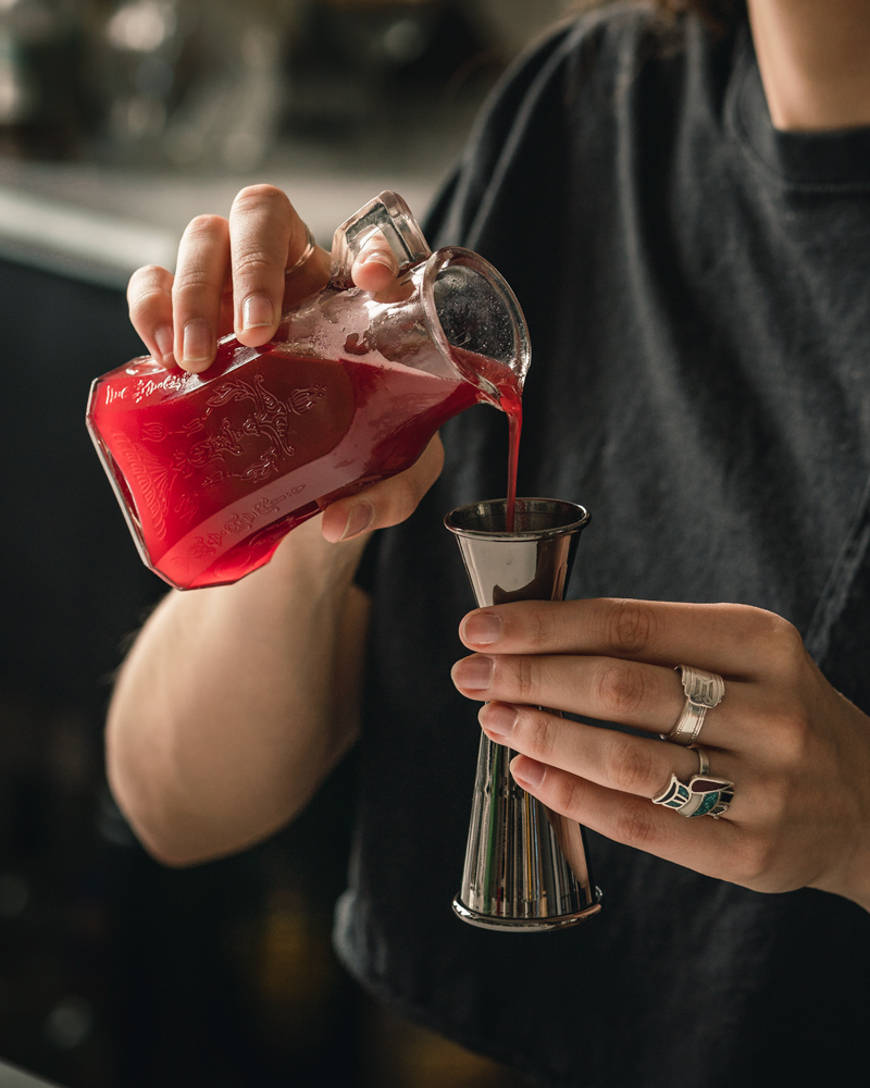 Measuring Raspberry Syrup with a Jigger