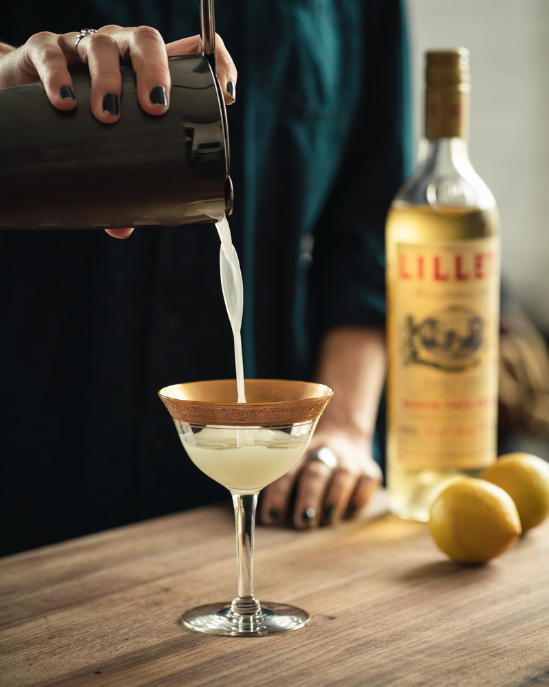 Pouring the Corpse Reviver into a cocktail glass
