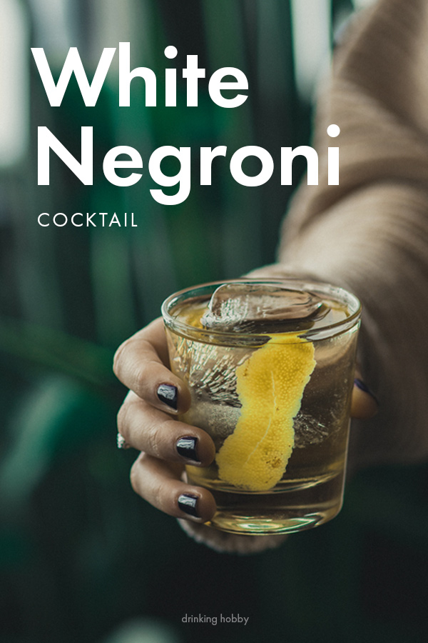 The white negroni cocktail with gin sweet vermouth and lemon zest