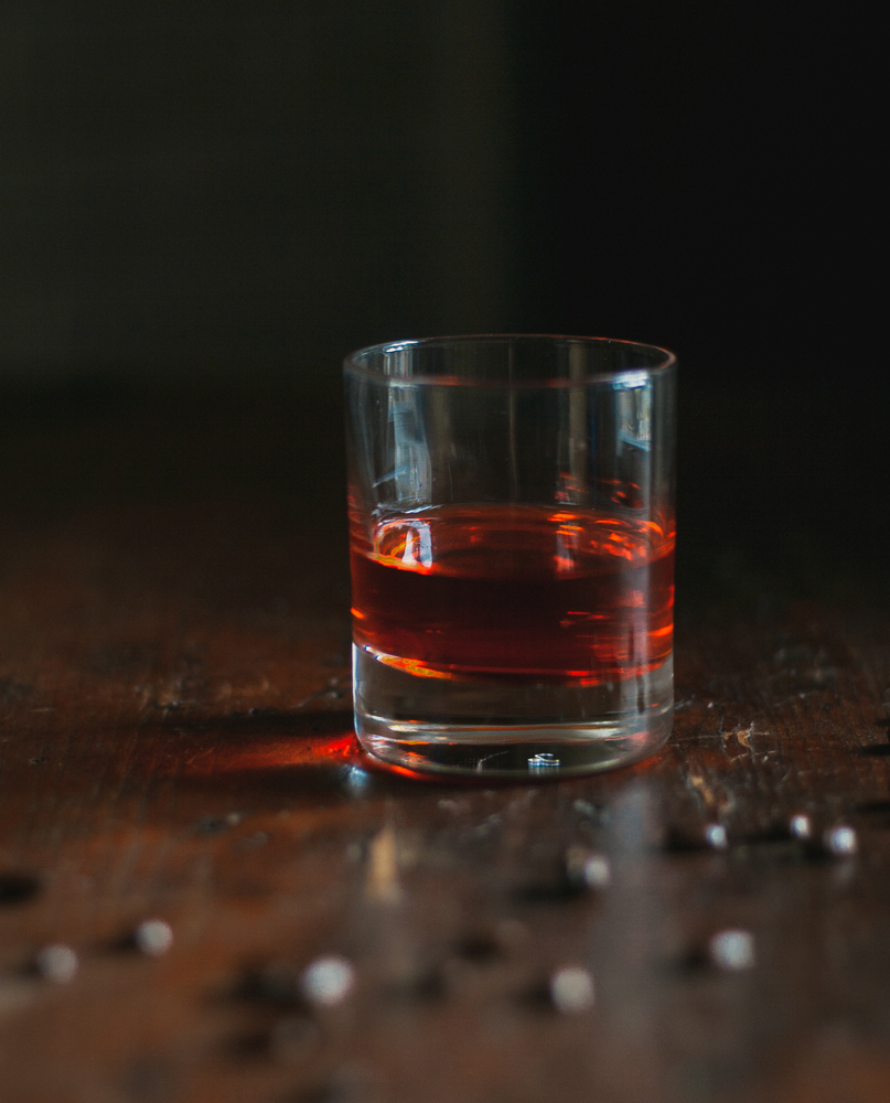 a negroni and coffee beans make an infused variation