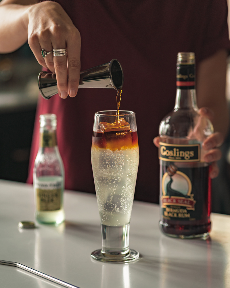 Pouring the Goslings rum on top of the dark n stormy