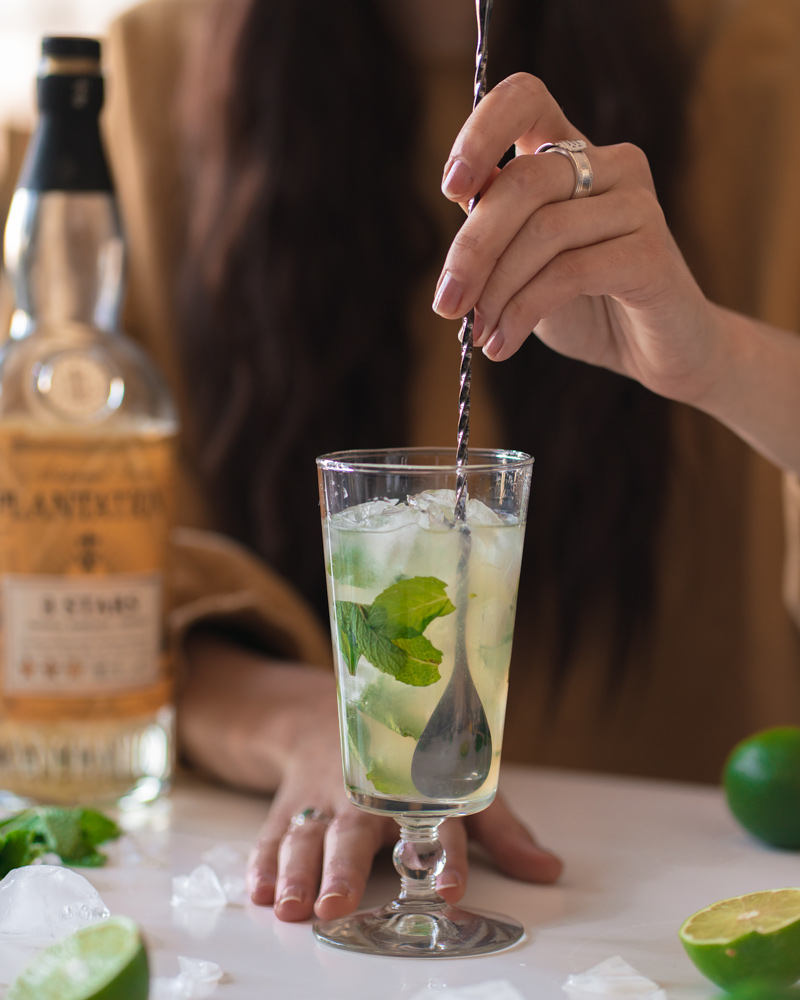 Stirring the mint and ice through the mojito