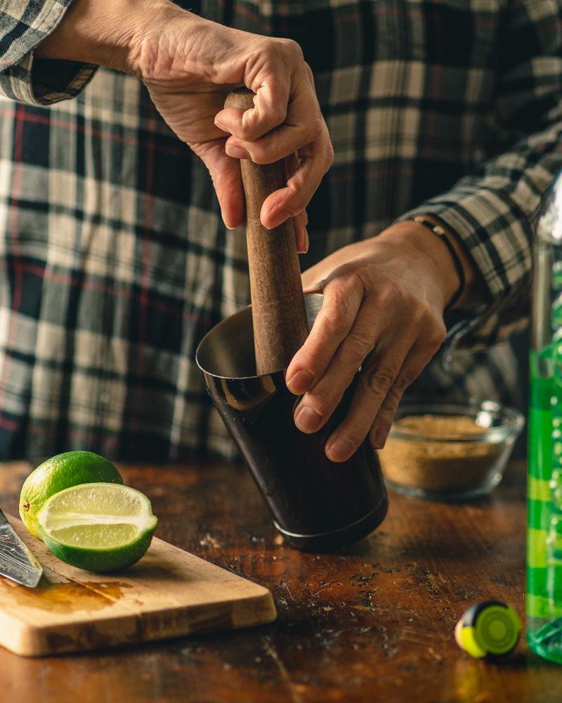 Muddling a refreshing Caipirinha