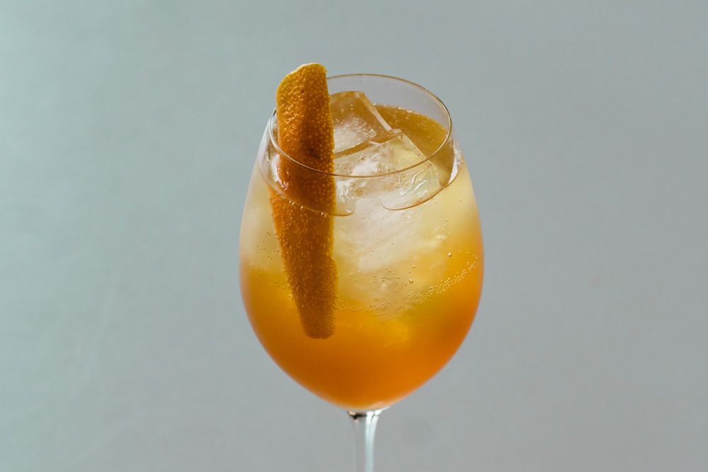 Amaro Spritz cocktail made with cocktail made with coganc and honey