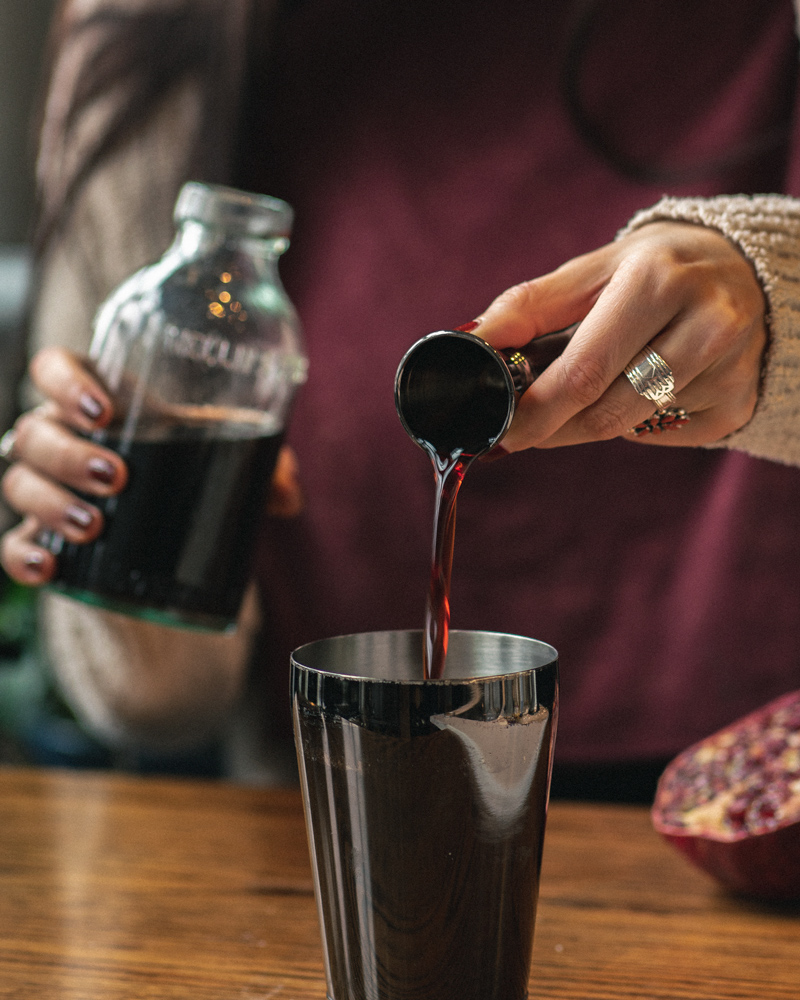 Pouring grenadine to use in a cocktail