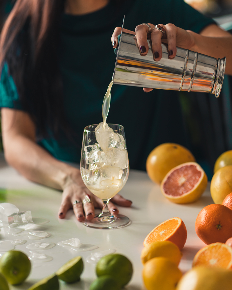 straining the gin and juice on the rocks