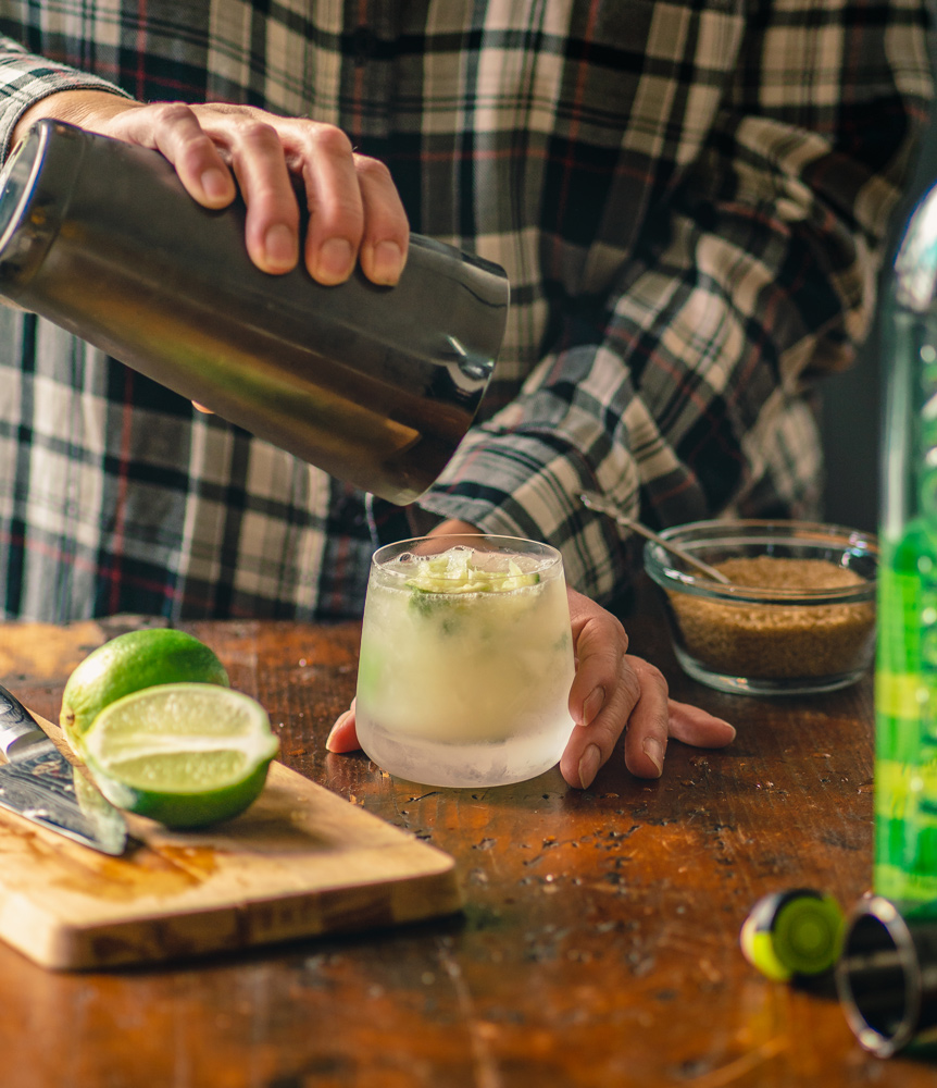 shaking crushed ice, limes, and cachaca