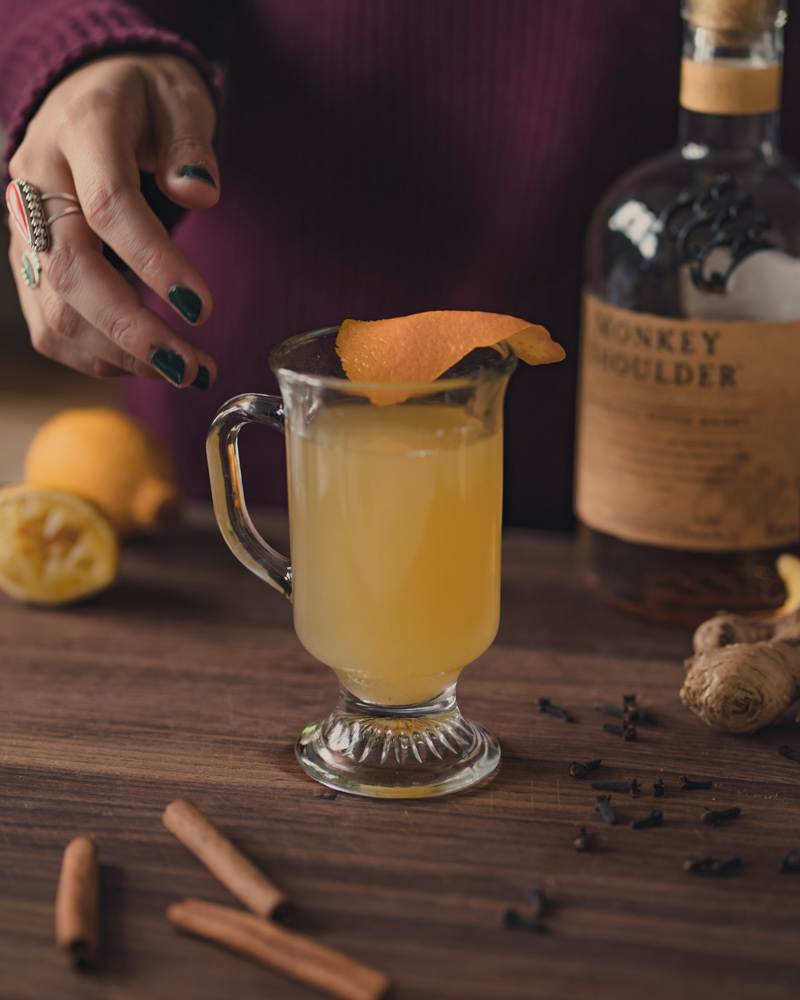 the final hot toddy with a piece of orange peel