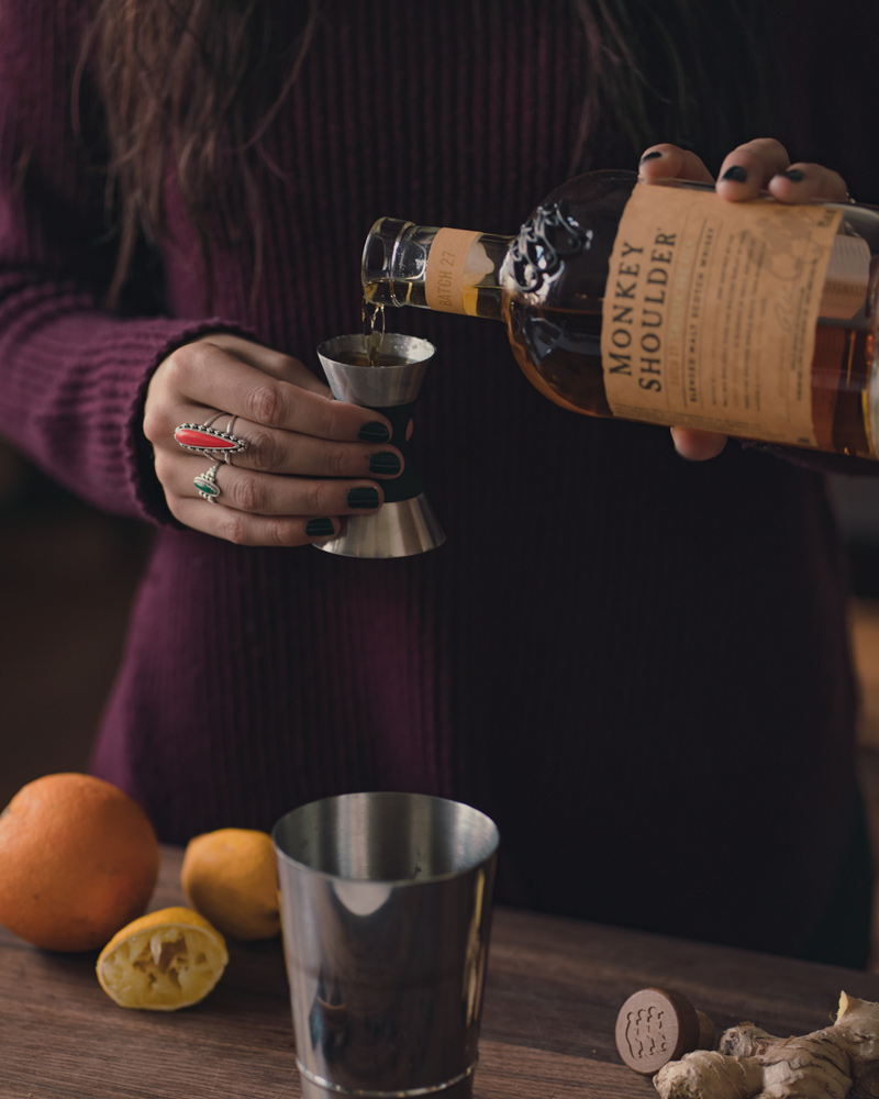 pouring monkey shoulder scotch into the shaker