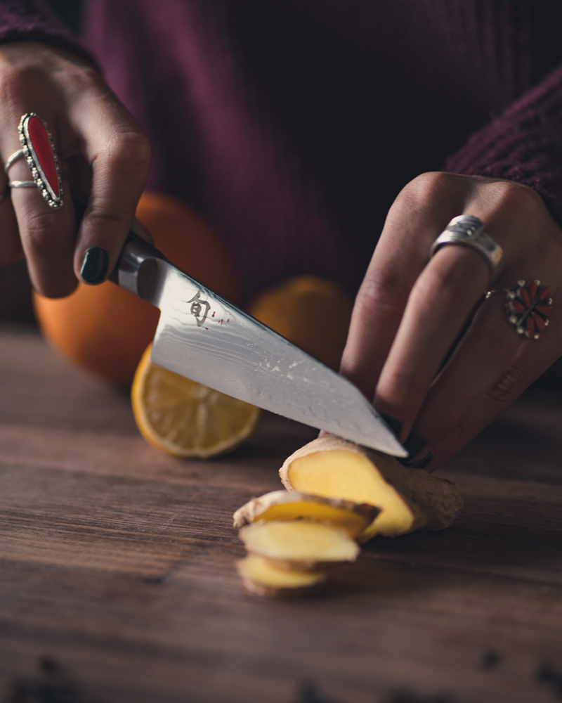 cutting slices of ginger to use in the drink recipe