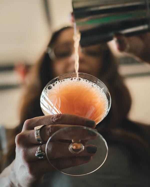 Straining the Jack Rose Drink