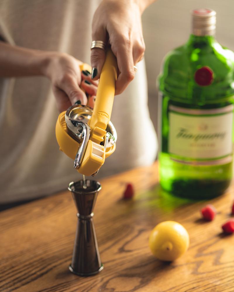 Squeezing fresh lemon juice