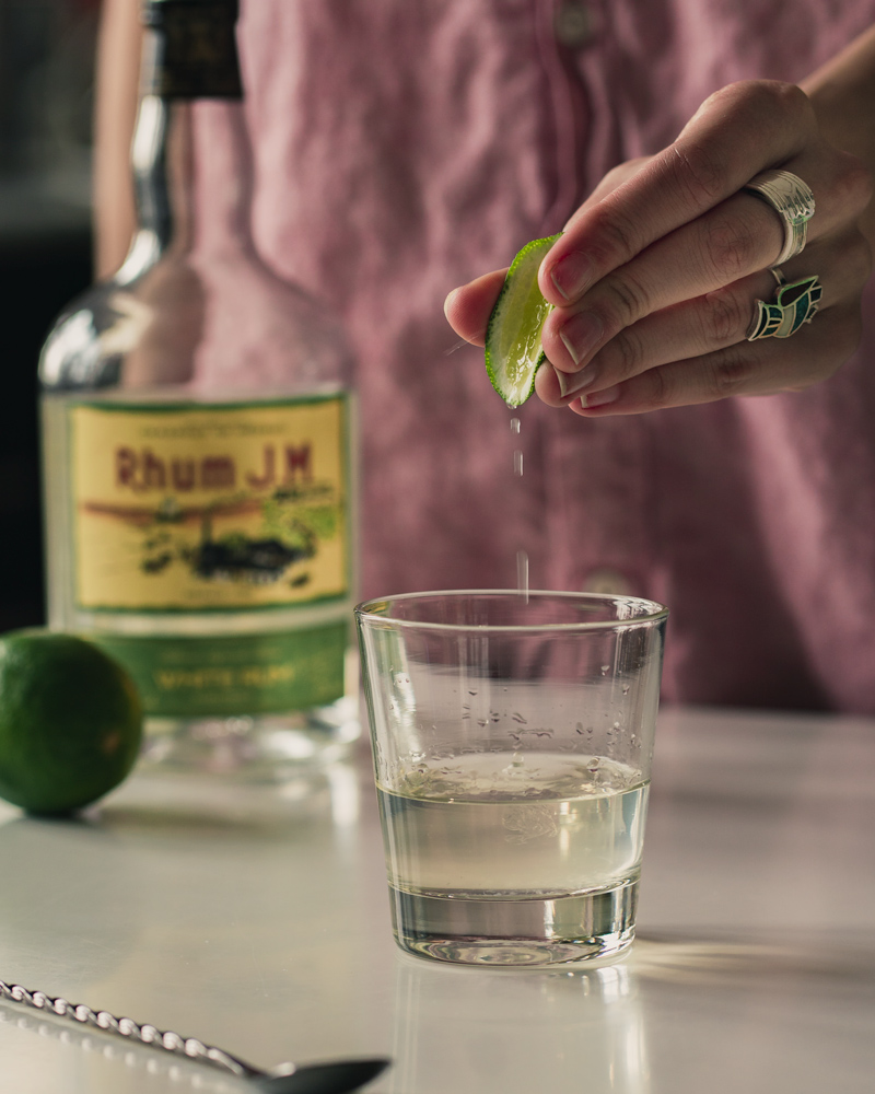 Squeezing lime into the glass