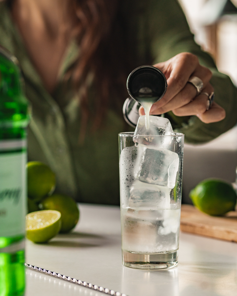 Measuring the lime juice into the glass
