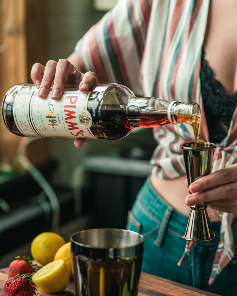 Pouring a Bottle of Pimms