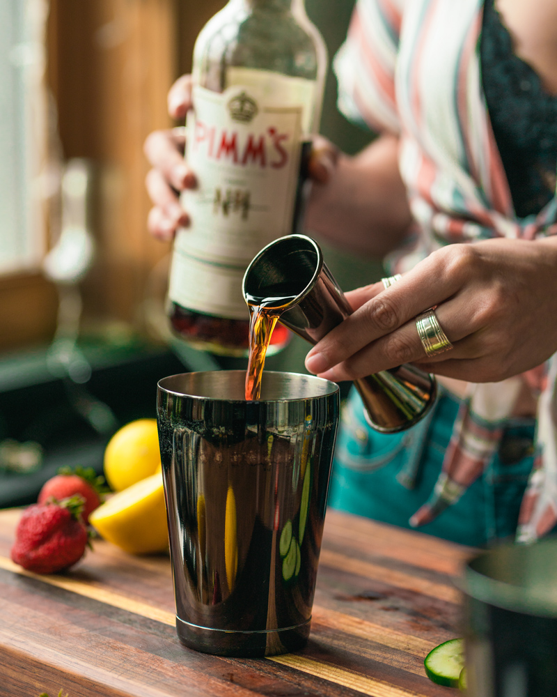 Pouring the jigger of pimms