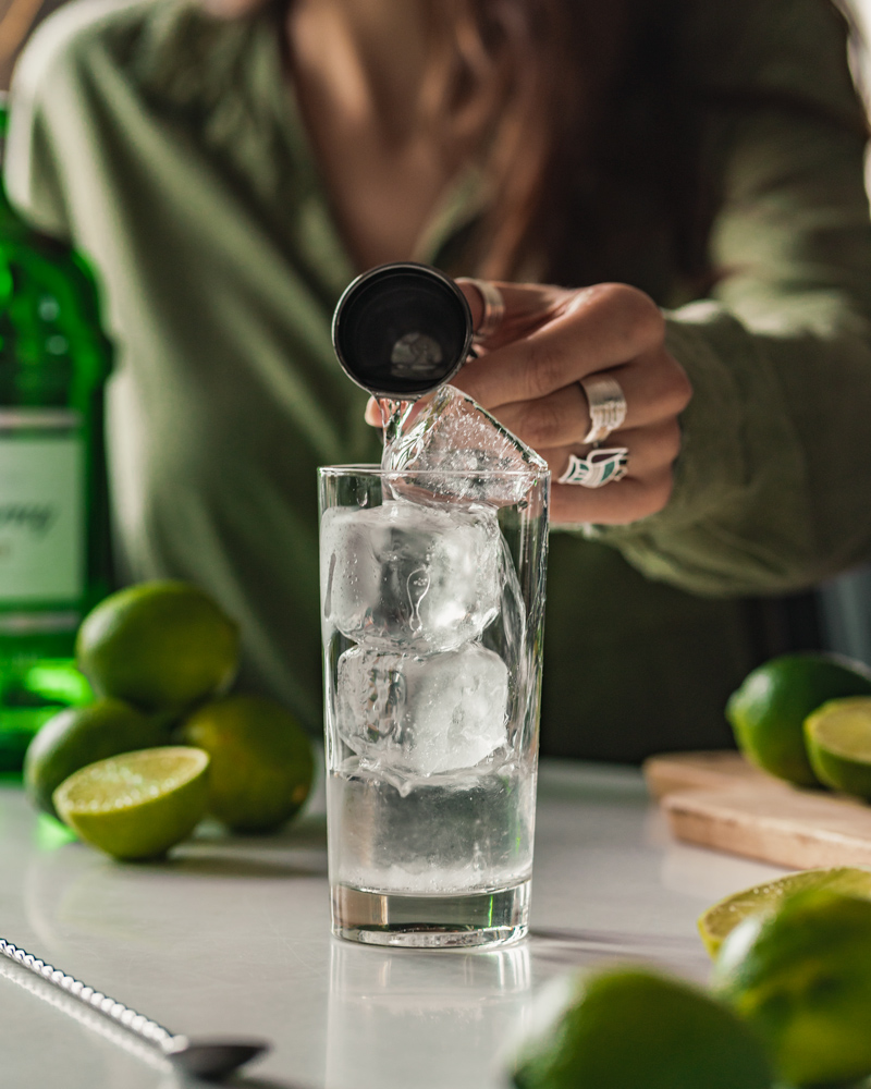 Pouring gin into the glass
