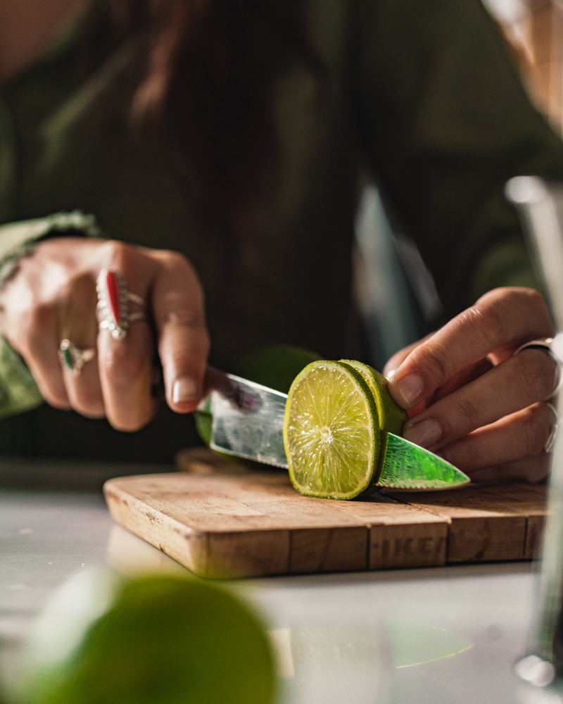 Slicing a lime garnish