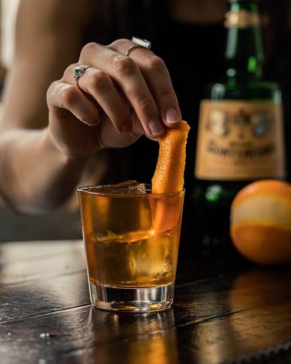 Black Manhattan with orange twist
