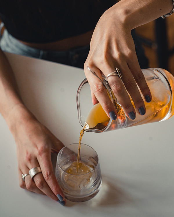 Straining an Old Fashioned in a mixing glass