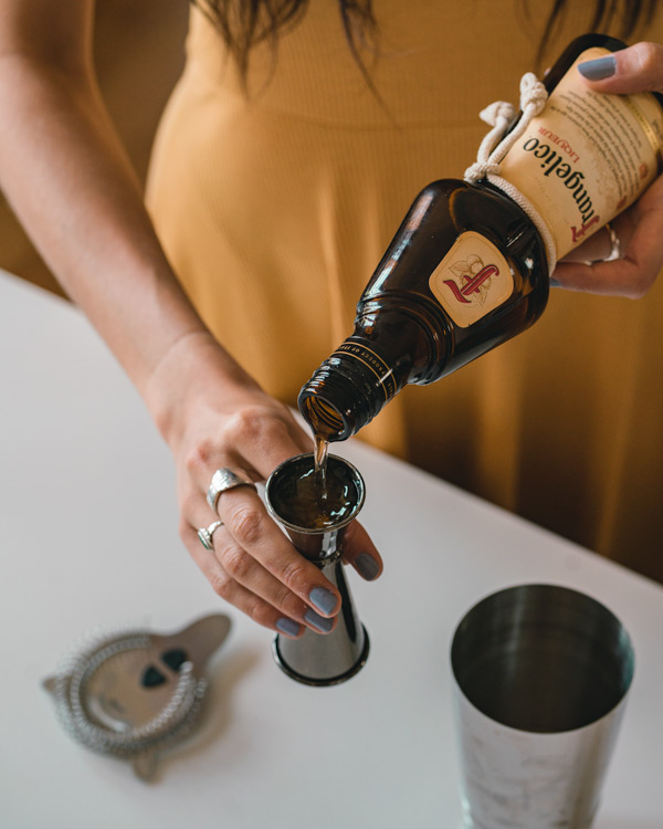 pouring a frangelico cocktail