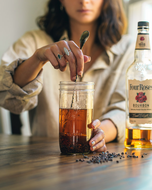 stirring chocolate infused whiskey