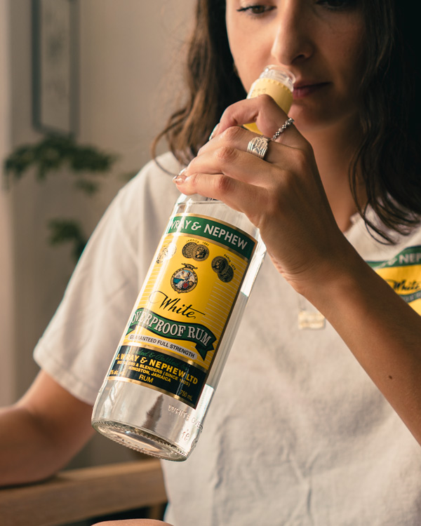 smelling a bottle of wray and nephew